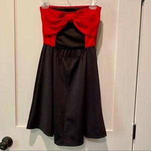 Newbury Kustom Open Back Mini Dress w/ Bow Accent